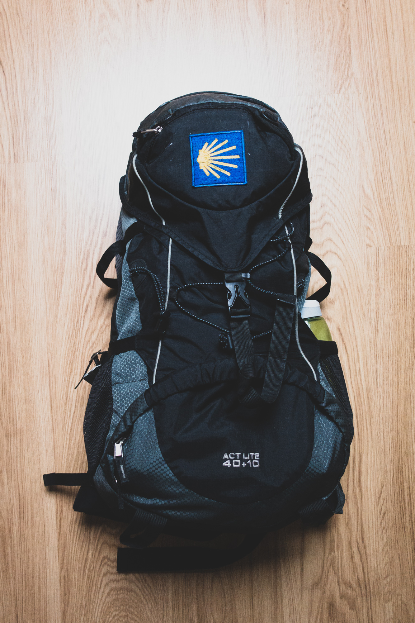 A full Deuter backpack on the floor